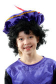 Little girl dressed as black pete — Stock Photo
