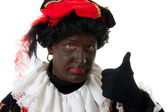 Zwarte Piet ( black pete) typical dutch character with thumbs up — Stock Photo
