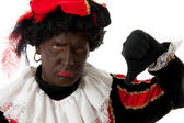 Zwarte Piet ( black pete) typical dutch character with thumbs do — Stock Photo