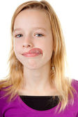 Young girl makes funny face — Stock Photo