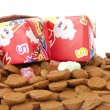 Bag with presents and typical dutch sweets: pepernoten (ginger n — Stock Photo