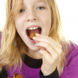 Girl with ginger nuts (pepernoten) — Stock Photo #4129984