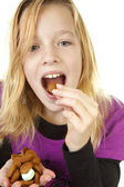 Girl with ginger nuts (pepernoten) — Stock Photo