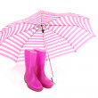 Pink umbrella and rain boots — Stock Photo