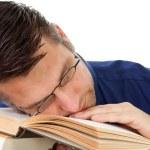 Nerdy geek fall asleep on books — Stock Photo #4152926