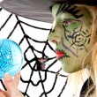 Royalty-Free Stock Photo: Portrait of green Halloween witch in closeup