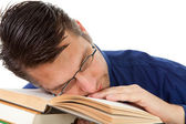 Nerdy geek fall asleep on books — Stock Photo