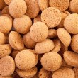 Background of typical dutch sweets: pepernoten (ginger nuts) — Stock Photo #4203475