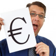 Nerdy geek is holding euro sign — Stock Photo