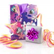 Bag with gift and party streamer — Stock Photo