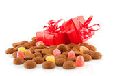 Typical dutch sweets: pepernoten and presents — Stock Photo