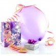 Bag with gift, balloon and party streamer — Stock Photo