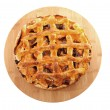 Delicious home baked apple pie on wooden cutting board — Stock Photo #4812591