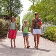Mother and daughters walking down the street — Stock Photo