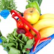 Filled with grocery blue red shopping basket — Stock Photo
