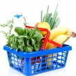 Filled with grocery blue red shopping basket — Stockfoto