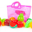 Pink plastic shopping bag with plastic grocery - Stock Photo