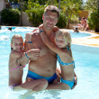 Father and daughters heaving fun in the swim pool — Stock Photo #4882648