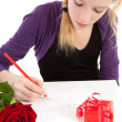 Young girl is writing be my valentine — Stock Photo