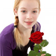 Young girl posing with red rose — Stock Photo