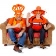Two Dutch soccer fan watching game — Stock Photo #4930900