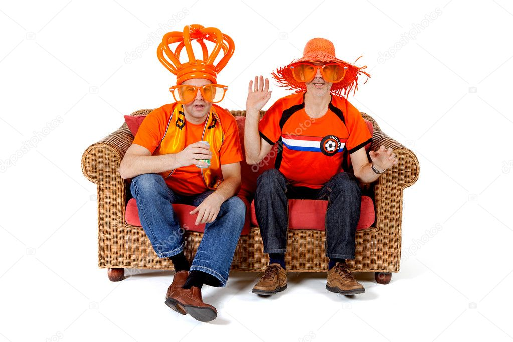 Two Dutch soccer fan watching game over white background — Stock Photo #4930900