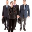 Four business , one young woman and three older men — Stock Photo