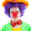 Portrait of child dressed as colorful funny clown - Stock Photo