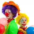 Stock Photo: Portrait of two children dressed as colorful funny clowns