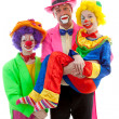 Three dressed up as colorful funny clowns — Stock Photo #5050109