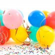 Colorful balloons, party streamers and confetti — Stock Photo