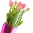 Dutch tulips in pink vase — Stock Photo