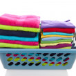 Basket filled with colorful folded laundry - Stock Photo