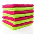 Pile of lime green and pink towels — Stock Photo