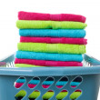 Laundry basket filled with colorful folded towels - Stock Photo