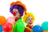 Portrait of two children dressed as colorful funny clowns — Stock Photo