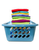 Laundry basket with folded clothes — Stock Photo