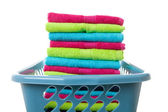 Laundry basket filled with colorful folded towels — Stock Photo