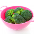 Pink colander with broccoli vegetable — Stock Photo