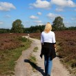 Stock Photo: Woman is walking in typical Dutch nature