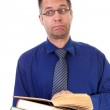 Male nerdy geek is reading books — Stock Photo #5123203