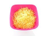 Ciotola rosa con formaggio grattugiato — Foto Stock