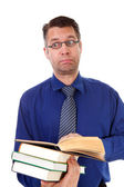 Male nerdy geek is reading books — Stock Photo