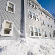 Blue three story house in winter - Stock Photo