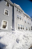 Blue three story house in winter — Stock Photo