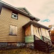 Stock Photo: Boarded up, broken down, abandoned, haunted house
