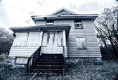 A boarded up, broken down, abandoned, haunted house — Stock Photo
