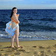 Attractive female at beach - Stock Photo