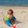 Baby on beach - Stock Photo