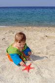 Baby on beach — Stock Photo